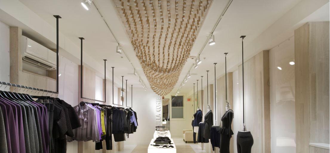 Decoraci n del interior tienda de ropa moda for Decoracion de negocios de ropa
